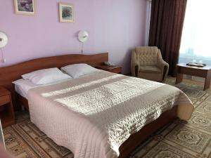 Кровать или кровати в номере Паллада