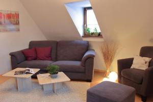Ein Sitzbereich in der Unterkunft Haus Kolmesfeld