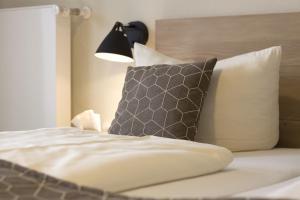 Кровать или кровати в номере Bavaria Biohotel