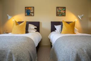 A bed or beds in a room at The Princess Victoria