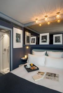 A bed or beds in a room at BoB Hotel by Elegancia