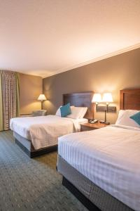 A bed or beds in a room at University Place Hotel and Conference Center