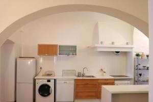 A kitchen or kitchenette at Casa Centro Histórico Beja - Castelo