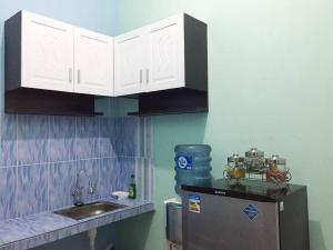 A kitchen or kitchenette at Villa Aviation by Masterpiece Villa