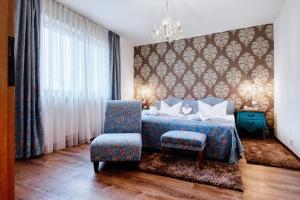 Ein Bett oder Betten in einem Zimmer der Unterkunft Central Hotel am Königshof