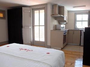 A cozinha ou cozinha compacta de Guest House Vimaranes
