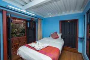 A bed or beds in a room at Kathmandu Boutique Hotel