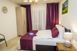 מיטה או מיטות בחדר ב-Palace