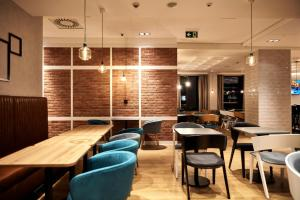 A restaurant or other place to eat at B&B Hotel Krakow Centrum
