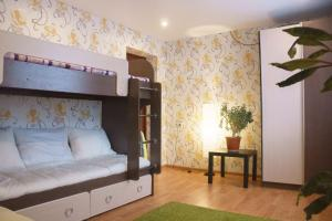 Двухъярусная кровать или двухъярусные кровати в номере Панорама