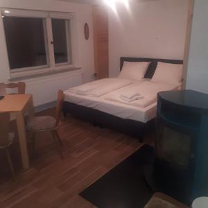 Ein Bett oder Betten in einem Zimmer der Unterkunft Waldhaus Crottendorf
