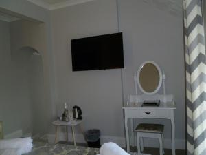 A television and/or entertainment center at Greenlaw Guest House