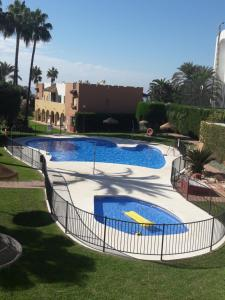 The swimming pool at or near Apartamento Playa El Playazo en Nerja