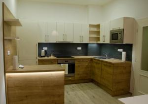 A kitchen or kitchenette at New City Centre Apartment