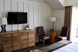 A television and/or entertainment center at Sunnyside Resort and Lodge