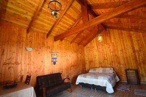 A bed or beds in a room at Cabaña molcosur