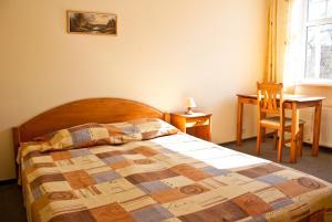 ホテル スカンステにあるベッド