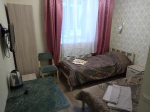 A bed or beds in a room at Harmony