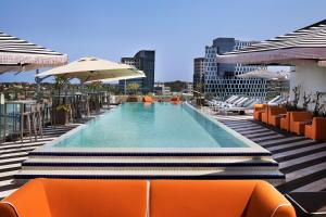The swimming pool at or near Publica Isrotel, Autograph Collection