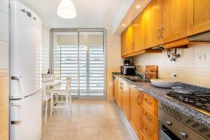 A kitchen or kitchenette at WHome | Casino Premium Apartment