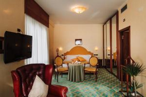 TV o dispositivi per l'intrattenimento presso Grand Hotel Excelsior