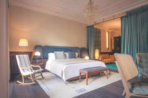A bed or beds in a room at Can Bordoy Grand House & Garden