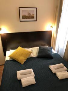 Кровать или кровати в номере Караванная 5