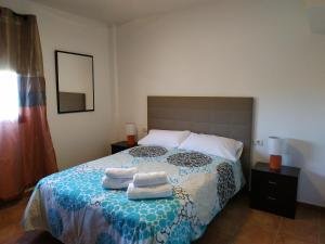 Cama o camas de una habitación en V V EL CHARCO