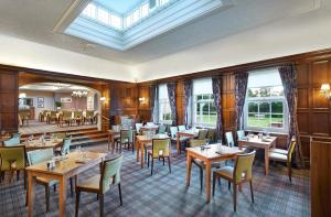 A restaurant or other place to eat at Hilton Avisford Park