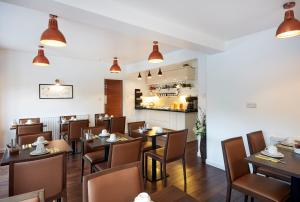 A restaurant or other place to eat at Conifers Guest House