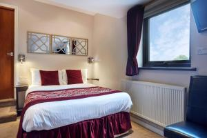 A bed or beds in a room at Conifers Guest House