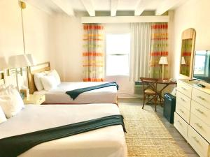 A bed or beds in a room at Broadmore Miami Beach