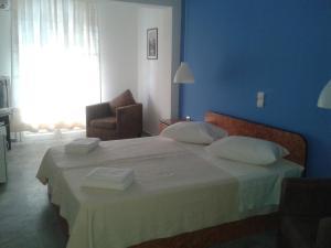Ένα ή περισσότερα κρεβάτια σε δωμάτιο στο Hotel Blue Fountain