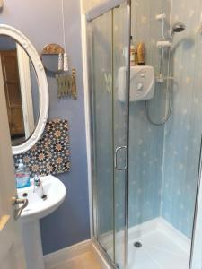 A bathroom at Larkside Cottage