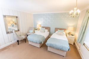 A bed or beds in a room at Grovefield Manor
