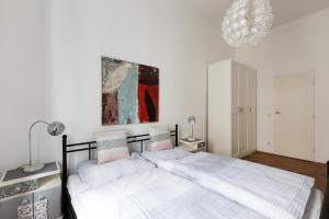 Postel nebo postele na pokoji v ubytování Gemütliche Wohnung mit Terrasse im Zentrum