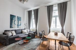 Posezení v ubytování Gemütliche Wohnung mit Terrasse im Zentrum