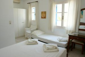 A bed or beds in a room at Blue Bay Villas