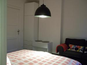 """Ein Bett oder Betten in einem Zimmer der Unterkunft """"Frosch & Fisch"""""""