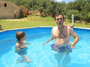 The swimming pool at or near Mas Can Puig de Fuirosos