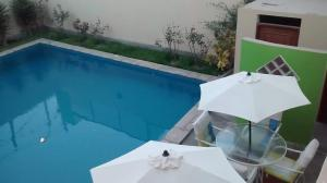 A view of the pool at Hotel Presidente or nearby