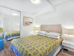 A bed or beds in a room at Iluka Twelve at Iluka Resort Apartments