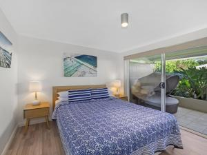 A bed or beds in a room at Poolside at Iluka Resort Apartments