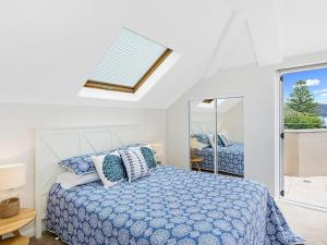 A bed or beds in a room at The Lookout at Iluka Resort Apartments