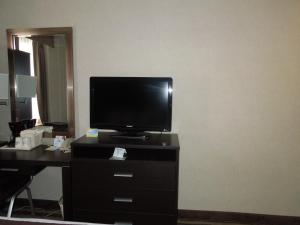 A television and/or entertainment center at Days Inn by Wyndham Jamaica / JFK Airport