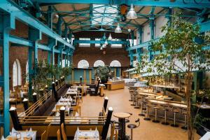 Ein Restaurant oder anderes Speiselokal in der Unterkunft Hotel Alte Werft