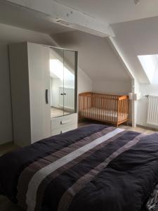 Un ou plusieurs lits dans un hébergement de l'établissement Gite de la Noye