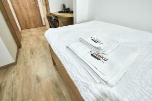 Postel nebo postele na pokoji v ubytování Penzion U Zámku