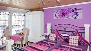 Un ou plusieurs lits dans un hébergement de l'établissement Pension Jäger (der Geheimtipp am Europa Park mit EP Eintrittskartengarantie)