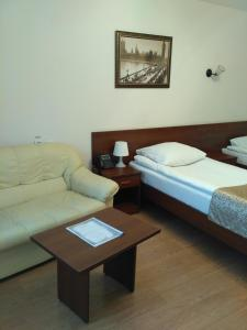 A bed or beds in a room at Kosmos Hotel